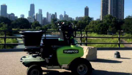 ExperiGreen equipment in front of Chicago skyline