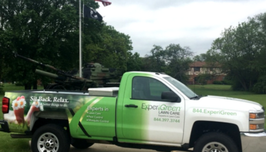 ExperiGreen truck in front of flagpole