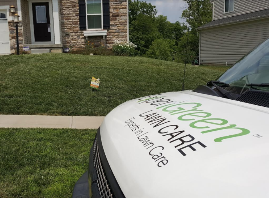 gorgeous green lawn behind hood of ExperiGreen vehicle