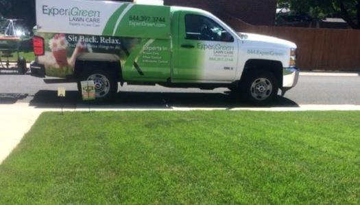 ExperiGreen lawn fertilization truck in front of green lawn