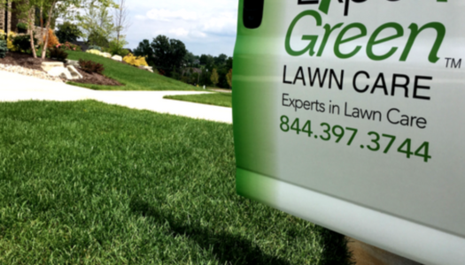 door of ExperiGreen vehicle in front of nice green lawn with landscaping